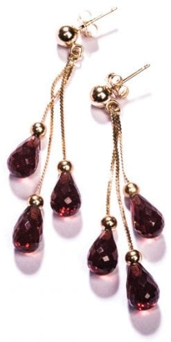 The new Ava Joy Earrings in garnet and 14ct yellow gold