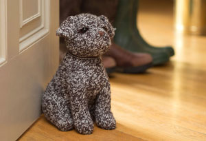 A smart Border terrier at your service: Dora Designs doorstop: a friend in waiting