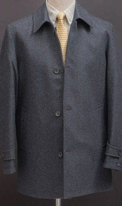 Ingenious reversible coat: Donegal tweed on one side, navy 'mac style' on the reverse