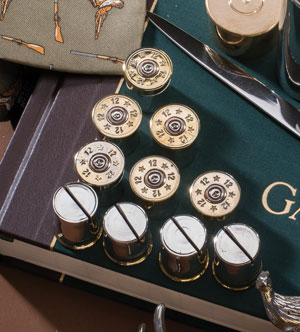 Set of fine hand-cast English pewter shotgun cartridge placecard holders, plated in silver
