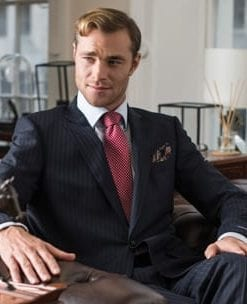 Six of the Best City Suits: the debonair navy pinstripe with red shadow stripe: suit with two pairs of trousers