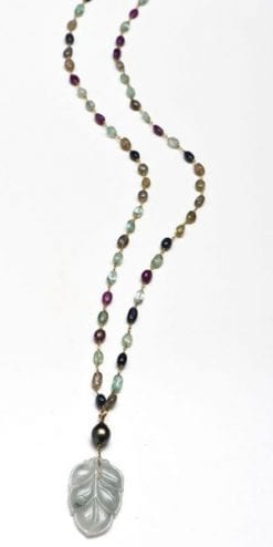 The new name in jewellery: the precious sautoir: the Isadora in natural jade, Tahitian black pearl, ruby, emerald and sapphire