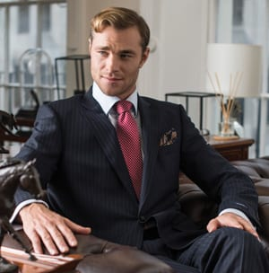 Six of the Best City Suits: the debonair navy pinstripe with red shadow stripe