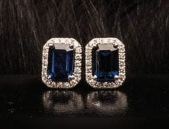 A special pair of emerald-cut blue sapphire earrings of nearly 2 carats, encrusted with diamonds in 18ct white gold from Hatton Garden