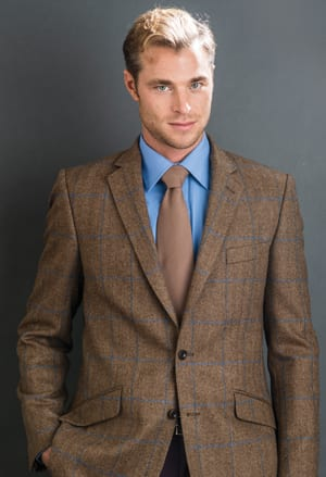 The new season's jackets: the elegantly tailored brown herringbone with blue overcheck