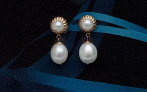 Scintillating Sun and Moon earrings in natural pearl and 14ct yellow gold