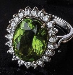 Exceptional vivid peridot, diamond and 18ct gold ring