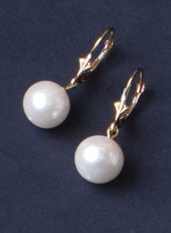 Classic beauty: natural round pearl earrings set on 14ct gold