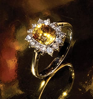 Natural yellow sapphire and diamond 18ct gold ring