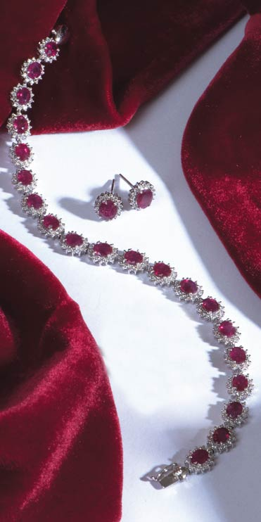 Thrilling Burmese ruby and diamond bracelet and cluster earrings set in  18ct white gold